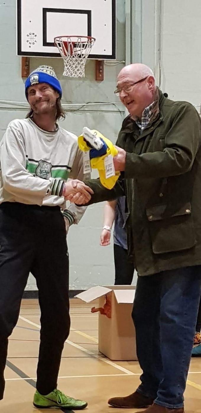 Ross Moon presenting hoodies to Braunton Football Ability Club