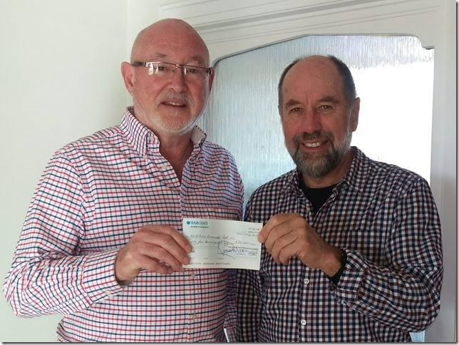 Ross Moon presenting a cheque for £25,000 to Ken Rutherford of the Braunton Countryside Centre