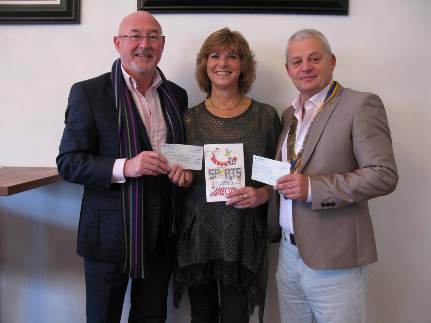 Mike Leverton President of Rotary Club of Braunton and Ross Moon presenting cheques to Trish Parsons for the Braunton Sports Directory
